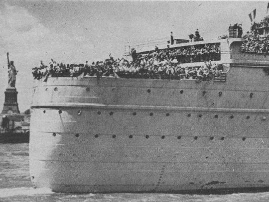 The Queen Mary, laden with immigrants and refugees,