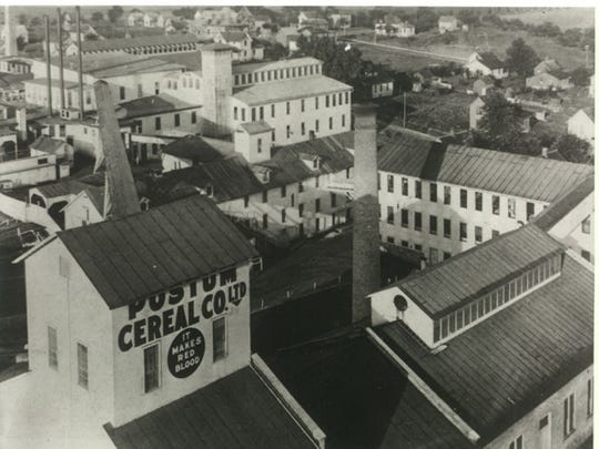 An aerial view of Postum Cereal Co. in 1904. Development of the Post Addition can be see beyond the company's location.