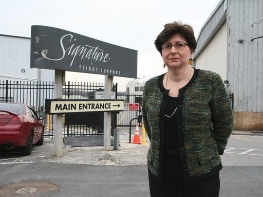 Legislator MaryJane Shimsky, stands outside the gate of Signature Flight Services at the Westchester County Airport.