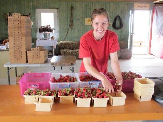 Theresa Bock, manager, Meuer Farm, makes up quarts