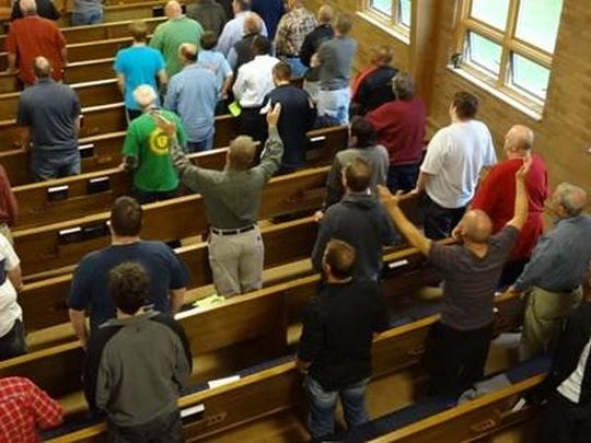 Participants give praise during the inaugural Men of Iron Conference last October at Christ Alone Church in Allouez. The church is hosting the second annual conference Saturday, Oct. 4, from 8 a.m.-3:30 p.m.