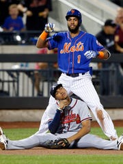 Mets shortstop Amed Rosario (1) reacts in front of