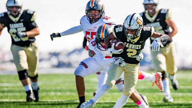 Amarillo High's Davin Lemmons (2) heads upfield for a gain after a reception in a game against Caprock last season. Amarillo High and Caprock, Class 5A Amarillo ISD schools, won't start practices until Sept. 7, a month after Class 1A-4A schools start their seasons.