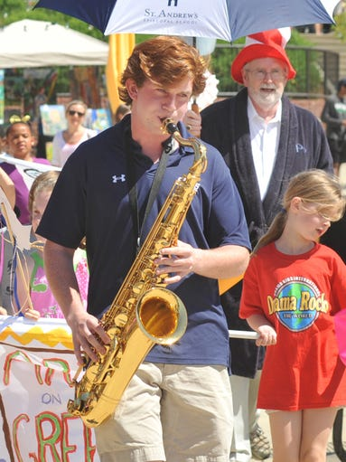 "St. Andrew's Episcopal School senior Benton Parker leads participants with his rendition of ""Oh, When the Saints Go Marching In"" during the opening parade at Saturday's Arts on The Green at St. Andrew's north campus in Ridgeland.The family event featured a fashion show, interactive 20-foot earth balloon, entertainment, games and a variety of venues to promote green living and the arts."
