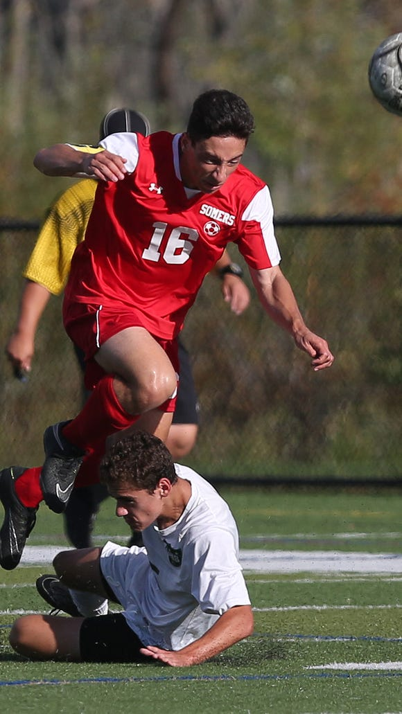 Somers Andrew Circle (16) gets tried up by Brewster's Patrick Feehan (5) during boys soccer game at Brewster High School Sept. 27, 2017. Somers won the game 1-0.