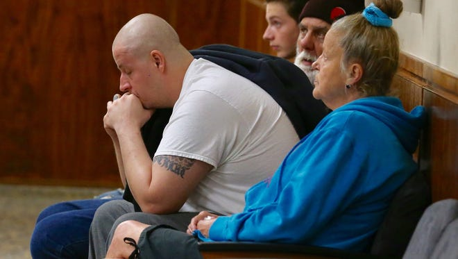 Michael Stagles cries as he waits to go into court on Friday. He pleaded guilty to criminally negligent homicide in the death of his daughter, Brook.