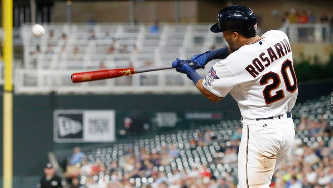 Eddie Rosario hits a solo home run off Seattle Mariners' Carlos Ruiz, a catcher pressed into service as a pitcher, during the eighth inning of Tuesday's game.