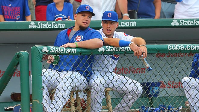 Chicago Cubs left fielder Kyle Schwarber (left) and left fielder Albert Almora Jr. (right) talk prior to the first inning against the Pittsburgh Pirates at Wrigley Field.