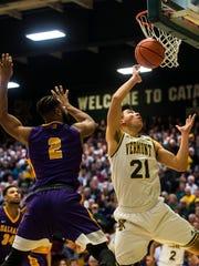 UVM's #21 Everett Duncan snags the rebound over Albany's