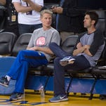 Golden State Warriors head coach Steve Kerr (left) and general manager Bob Myers (right) are looking to keep upgrading their team.