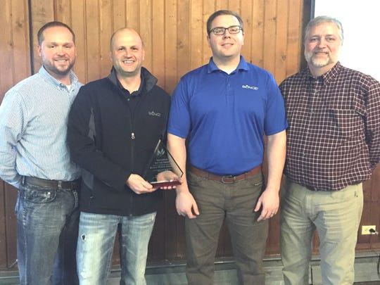 Representatives of Bunge North America in Bellevue accept the Agricultural Service Award on Friday. From left are Jeff Sprouse, safety manager; Jeff Davenport, area supervisor; Ryan Bumb and Paul Riehm, grain merchandisers.