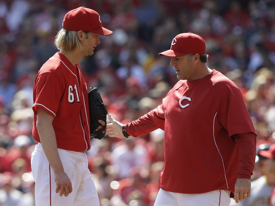 Bryan Price has had Bronson Arroyo as a veteran on his staff but has also helped bring along young pitchers such as Mike Leake, Aroldis Chapman and J.J. Hoover. The Reds ERA was 3rd and 4th in the NL the past two seasons. Associated Press/Al Behrman Cincinnati Reds starting pitcher Bronson Arroyo (61) talks with pitching coach Bryan Price during the third inning of a baseball game against the Pittsburgh Pirates, Saturday, Sept. 28, 2013, in Cincinnati. (AP Photo/Al Behrman)