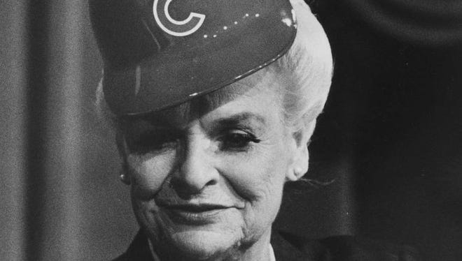 Rose Mofford sits at a table with popcorn and a Chicago Cubs hat during the Dwight Patterson roast at Centennial Hall, Mesa, November 1988.