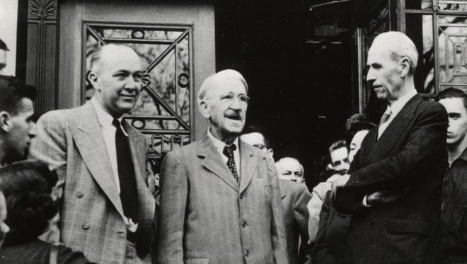 John Dewey addresses students in front of the Waterman Building at the University of Vermont on Oct. 26, 1949 while in Burlington to attend celebration of his 90th birthday at the university. From left are UVM Professor George Dykhuizen, Dewey and Elias Lyman, acting UVM president.