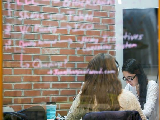 University of Delaware students work in one of the rooms at the Horn Program in Entrepreneurship's Venture Development Center.