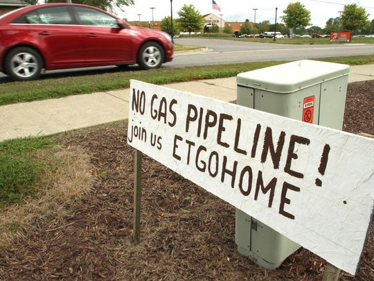 A hand-lettered sign on M-36 in Putnam Township protests