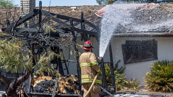 Visalia Fire department responded to a fire in the 800 block of East Vassar Street on Monday, June 11, 2018. A woman home at the time said the fire started in a tree in the backyard and moved to a gazebo and eventually blackened the home's roofline as well. No injures were reported.
