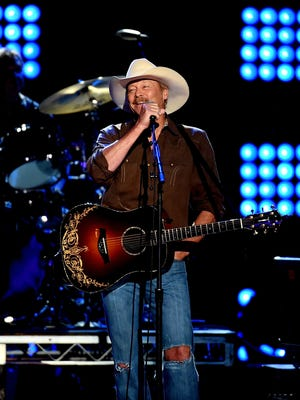 Alan Jackson performs onstage during ACM Presents: Superstar Duets at Globe Life Park on April 18, 2015 in Arlington, Texas.