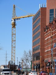 The tower crane went up late last week in the parking lot near the River's Edge Convention Center and was supposed to begin operating Monday.