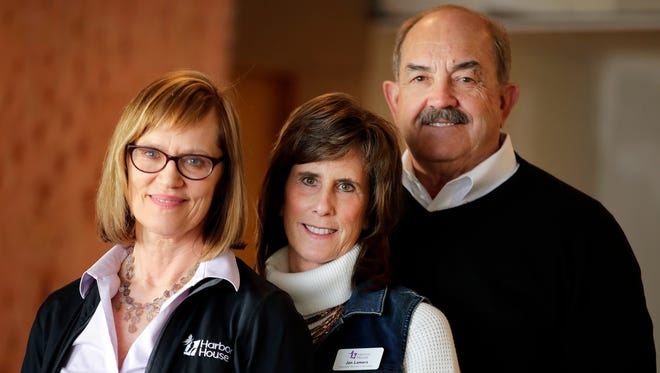 Beth Schnorr, executive director of Harbor House Domestic Abuse Programs, Jan Lamers, a volunteer at Harbor House, and Denny Lamers, president of McMahon, are the recipients of the Business Partnership Award between Harbor House and McMahon.