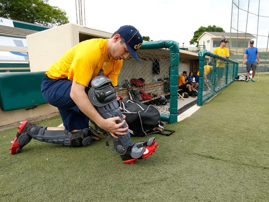 Catcher Anthony Sanchez puts on his gear as the Lafayette