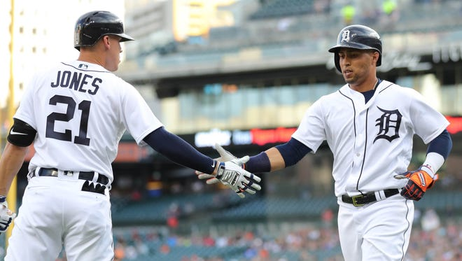 Detroit Tigers Leonys Martin is met by JaCoby Jones after scoring against the Los Angeles Angels  during first inning action Thursday, May 30, 2018, Comerica Park in Detroit, Mich.