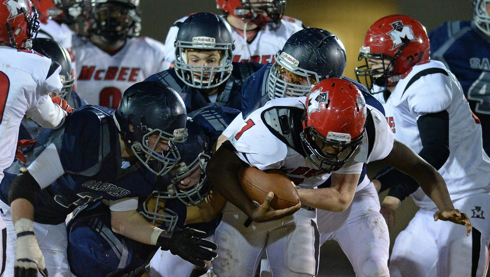 McBee's Dashonnell Wright (7) is brought down by the