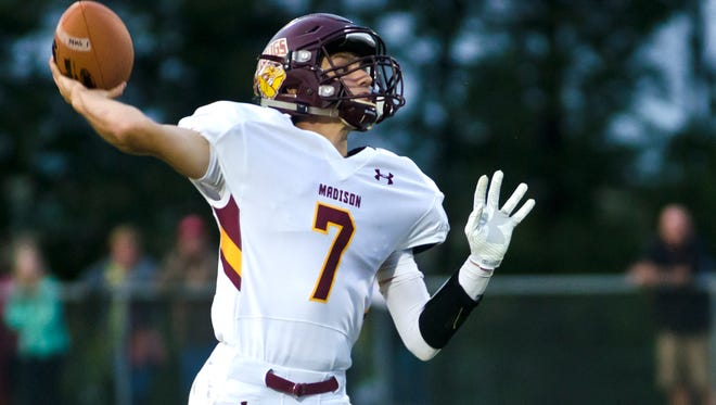 Madison quarterback Josh Giles throws the ball Friday, Aug. 26, at Dell Rapids.