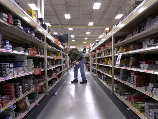 Larry Thiel of Appleton shops for ammunition at Mills Fleet Farm in preparation for the upcoming deer gun season.