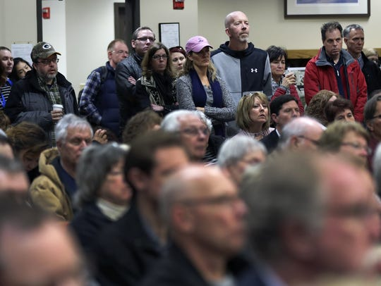 A large crowd listens to Mayor Tim Hanna give a presentation on the proposed new Appleton Public Library and mixed-use development during a meeting on March 15.