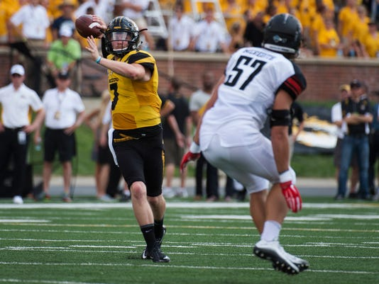 Missouri quarterback Maty Mauk, left, throws a pass over Southeast Missouri State's Chad Meredith, right, during the first half of an NCAA college football game Saturday, Sept. 5, 2015, in Columbia, Mo. (AP Photo/L.G. Patterson)