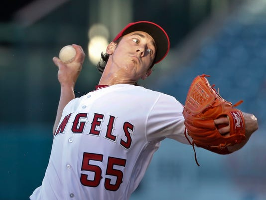 FILE - In this Tuesday, July 19, 2016 file photo, Los Angeles Angels starting pitcher Tim Lincecum works against the Texas Rangers in the first inning of a baseball game in Anaheim, Calif. A person with knowledge of the negotiations says two-time NL Cy Young Award winner Tim Lincecum is in discussions with the Texas Rangers on a one-year deal. The person spoke on condition of anonymity Tuesday, Feb. 27, 2018 because no contract had been reached. (AP Photo/Lenny Ignelzi, File)