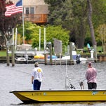 Boats are seen on the Great Egg Harbor River, docked behind riverfront properties or near the bulkhead in Mays Landing.