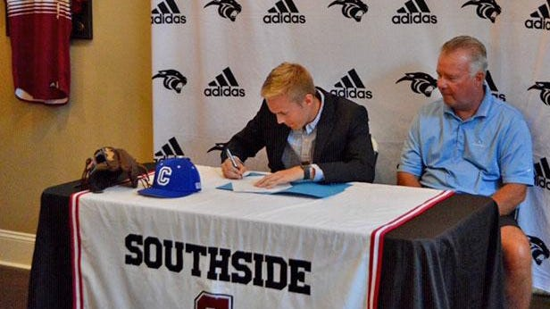 Southside's Brock Ford, seated next to his father Lloyd Ford, held a signing ceremony at his house as he'll play baseball at Covenant College.