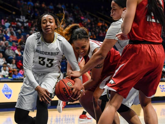 Vanderbilt guard Christa Reed (33) and Arkansas forward/center Kiara Williams (10) struggle for a rebound in the second half Wednesday.