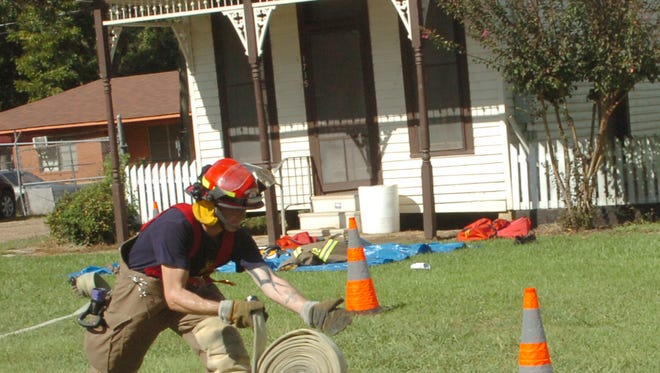 A fireffighter takes part in a skills contest at a previous Firefighters Appreciation Celebration. This year's event will begin at 10:30 a.m. Saturday at the state mega-shelter near LSUA.