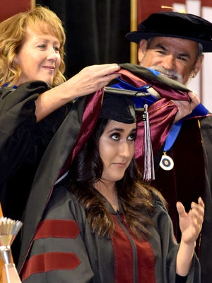 NMSU Doctorial graduates participate in a special hooding ceremony the Friday evening before commencement on Saturday.