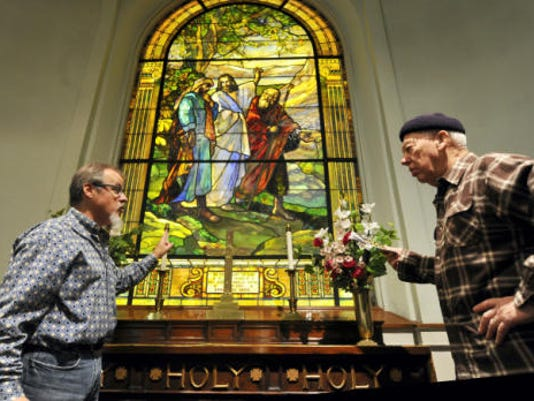 Terrence Dutchie Downs, left, discusses the Rudy art glass at First Moravian Church with Bill Kopp, of Hanover, during a walking tour in York on Saturday. The tour was part of a fundraiser for the Rudy Collective and Historic York Inc.