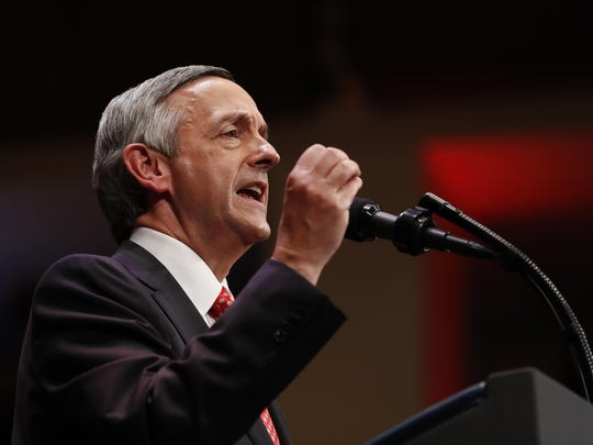 """FILE - In this July 1, 2017, file photo, Pastor Robert Jeffress of the First Baptist Dallas church speaks as he introduces President Donald Trump during the Celebrate Freedom event at the Kennedy Center for the Performing Arts in Washington. A few of President Donald Trump's leading evangelical supporters defended him after he questioned why the U.S. should accept more immigrants from Haiti and """"s—hole countries"""" in Africa. However, many other evangelicals condemned his remarks, citing their increasing devotion to fellow Christians overseas, along with the large numbers of immigrants in U.S. churches and their families. (AP Photo/Carolyn Kaster, File)"""