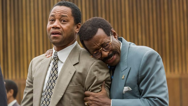 O.J. Simpson (Cuba Gooding Jr.) and attorney Johnnie Cochran (Courtney B. Vance) react to the verdict in FX's 'The People v. O.J. Simpson: American Crime Story.'
