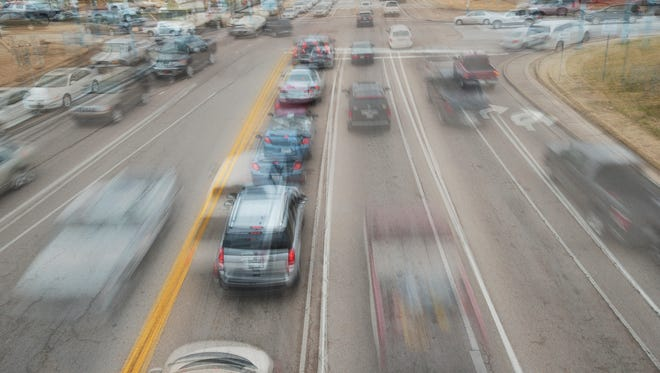 A photo illustration merges multiple images of traffic on Vann Drive taken over a two-minute period on a Wednesday afternoon.