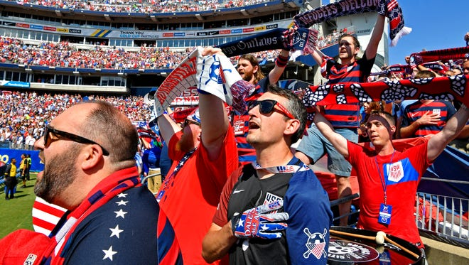 Justin Brunken, center, sings the national anthem along with other American Outlaws and a crowd of 47,622 before the US meets Panama in the Concacaf Gold Cup at Nissan Stadium.  Saturday July 8, 2017, in Nashville, TN