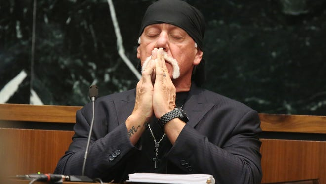 Hulk Hogan takes a moment as attorneys talk to the judge in court  during his trial against Gawker Media.