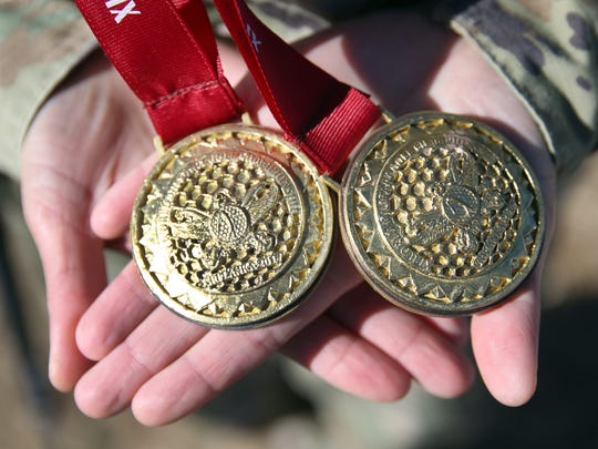 Spc. Melanie De Leon of Fort Bliss holds the individual and team gold medals won at the World Military Golf Championships in Sri Lanka.