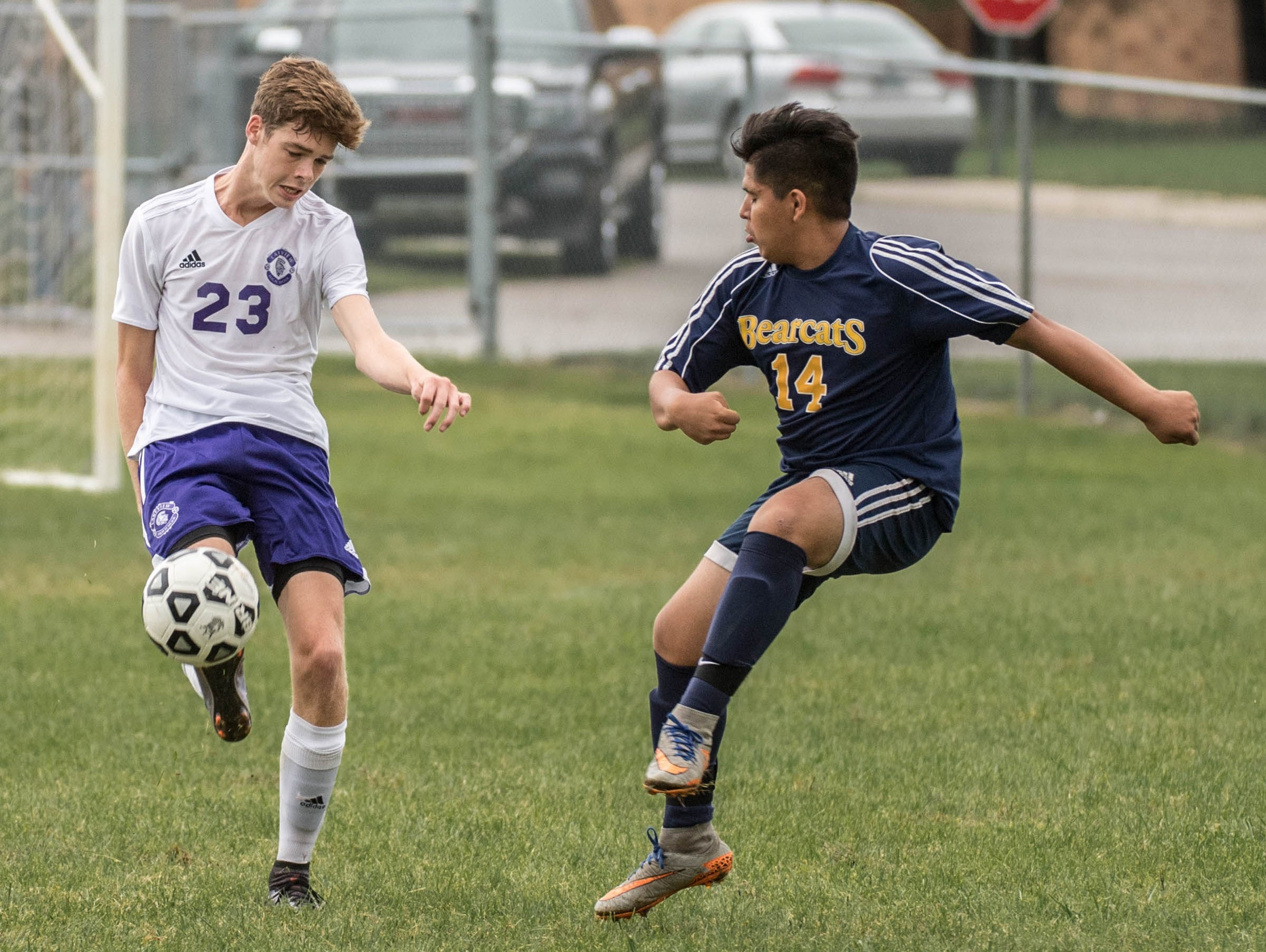 Lakeview's Cooper Grosteffon (23) and Battle Creek Central's Jose Chavez (14) during the All-City Soccer Championship on Saturday.