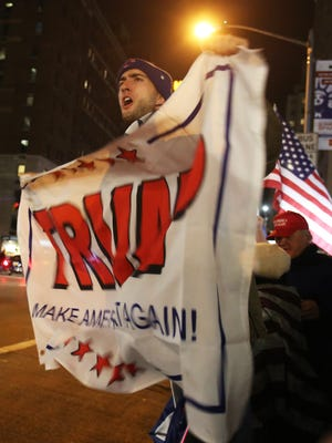 Jim Combs of Rochester cheers for Donald Trump outside of the Hilton Hotel in Midtown on Tuesday, November 8, 2016.