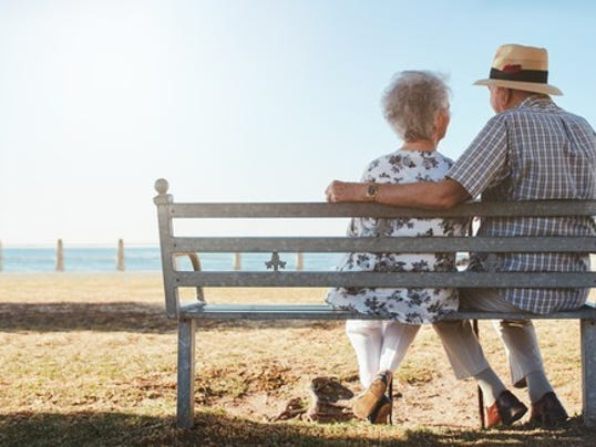 elderly-senior-couple-sitting-on-a-bench-on-the-beach_large.jpg