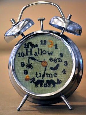 A Halloween-themed clock was among the entries Tuesday, Sept. 5, 2017, in the Needlepoint division for the West Texas Fair & Rodeo. The fair starts this weekend at the Taylor County Expo Center.