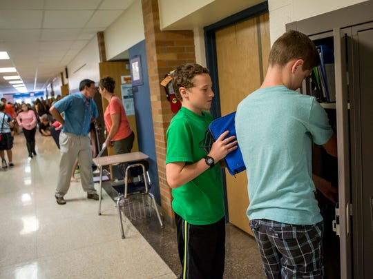 Seventh-grade students DJ Spurlock and Kaleb Hodgkins, both 12, share a locker due to increased enrollment Tuesday, September 13, 2016 at Marysville Middle School. Spurlock, who lives in Smith's Creek, is enrolled at the school through Schools of Choice.