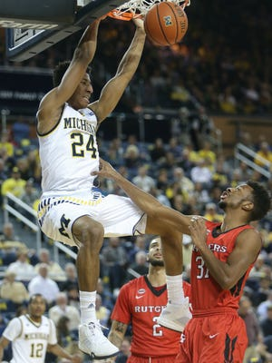 University Michigan Wolverines Aubrey Dawkins scores against the Rutgers Scarlet Knights Omaro Grier during first half action on Wednesday January 27 ,2016 at the Crisler Center Ann Arbor MI. Kirthmon F. Dozier/Detroit Free Press